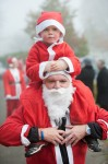 santa-run-child-on-father-christmas-shoulders