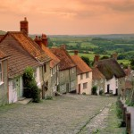 gold-hill-thatched-roofs-pink-sunset