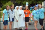 Little Sisters of the Poor greet race participants and volunteers.