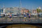 Runners crossing Hull Marina
